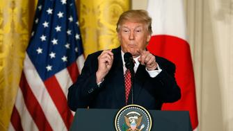 U.S. President Donald Trump gestures as he holds a joint press conference with Japanese Prime Minister Shinzo Abe (not pictured) at the White House in Washington, U.S., February 10, 2017.   REUTERS/Jim Bourg