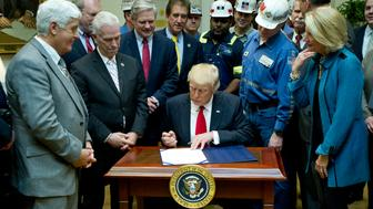 WASHINGTON, DC - FEBRUARY 16:  U.S. President Donald Trump signs H.J. Res. 38, disapproving the rule submitted by the US Department of the Interior known as the Stream Protection Rule in the Roosevelt Room of the White House on February 16, 2017 in Washington, DC.  The Department of Interior's Stream Protection Rule, which was signed during the final month of the Obama administration, 'addresses the impacts of surface coal mining operations on surface water, groundwater, and the productivity of mining operation sites,' according to the Congress.gov summary of the resolution. (Photo by Ron Sachs-Pool/Getty Images)