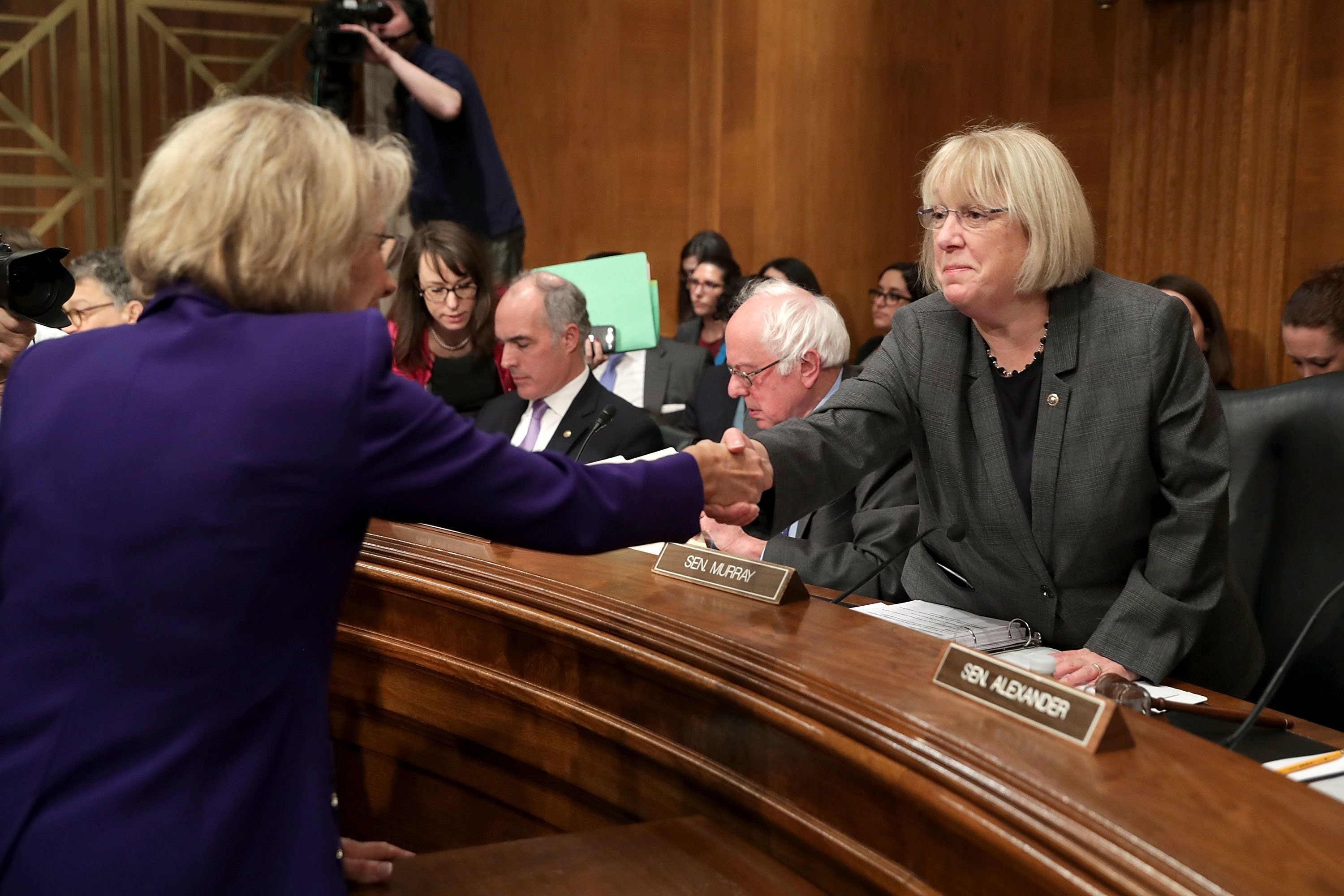 WASHINGTON, DC - JANUARY 17:  Betsy DeVos (L), President-elect Donald Trump's pick to be the next Secretary of Education, greets Senate Health, Education, Labor and Pensions Committee ranking member Sen. Patty Murray (D-WA) before DeVos' confirmation hearing in the Dirksen Senate Office Building on Capitol Hill  January 17, 2017 in Washington, DC. DeVos is known for her advocacy of school choice and education voucher programs and is a long-time leader of the Republican Party in Michigan.  (Photo by Chip Somodevilla/Getty Images)