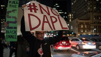 Protesters gather to denounce the Army Corps of Engineers decision to grant an easement for the Dakota Access Pipeline. Los Angeles, California. February 8, 2017. President Trump signed an executive action to green light the pipeline that passes under the Missouri River which supplies drinking water to the Standing Rock Sioux Tribe. (Photo by Ronen Tivony/NurPhoto via Getty Images)
