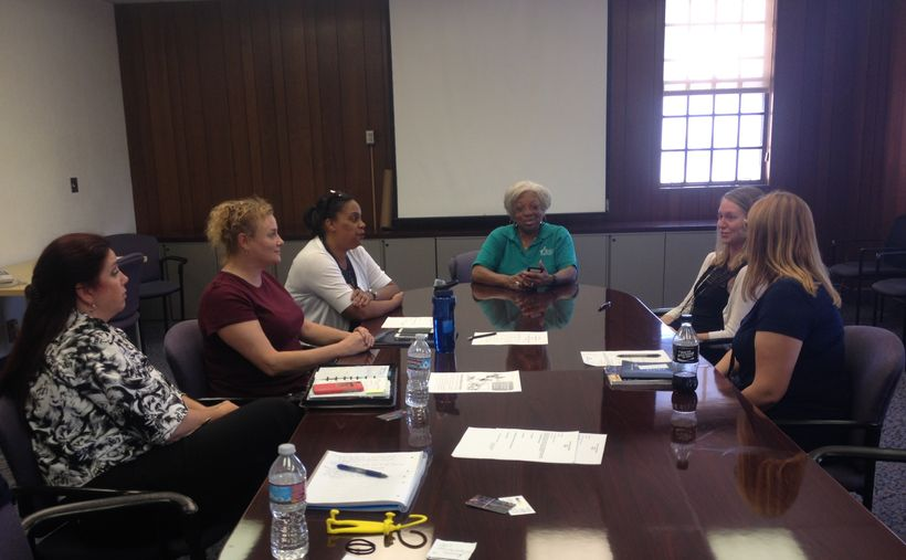 Six women veterans and veterans advocates network during a meeting of the Women Veterans Collaborative in Los Angeles.