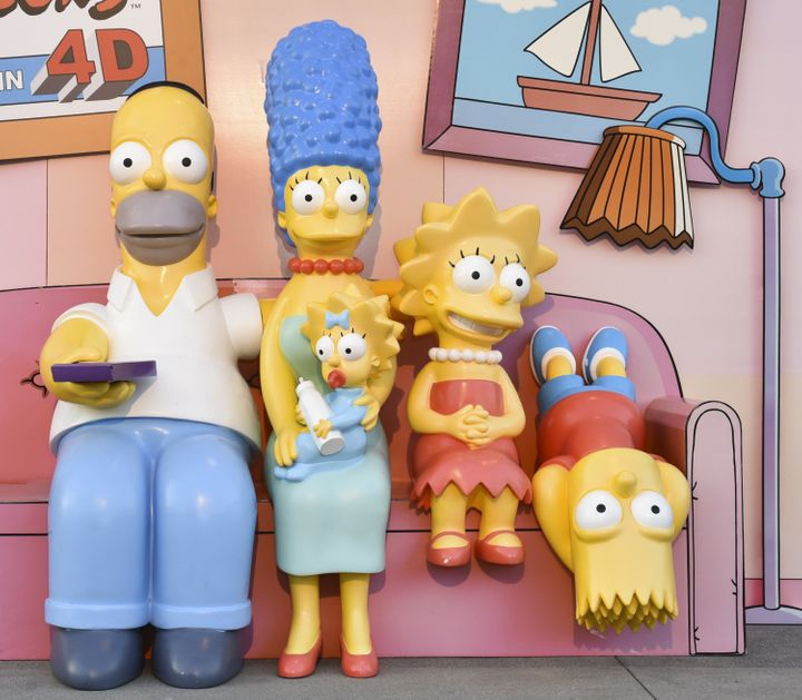Life-size replicas of Homer, Marge, Maggie, Lisa and Bart Simpson appear at the Couch Gag Virtual Reality Experience in Los A