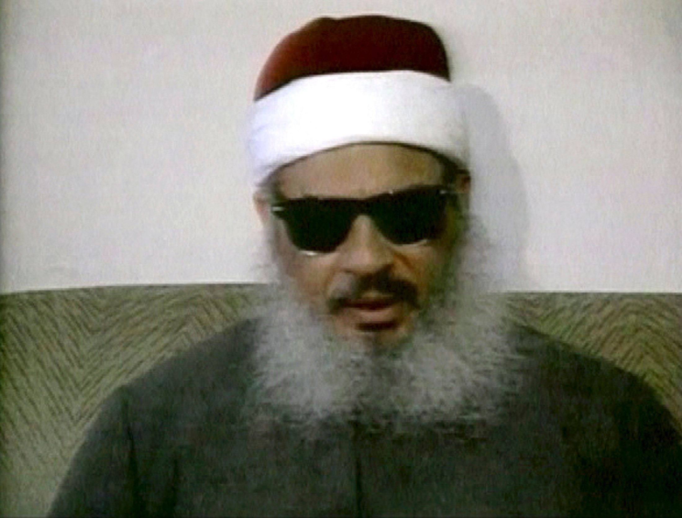 Egyptian Omar Abdel-Rahman speaks during a news conference in this still image taken from February 1993 video footage on January 18, 2013. The Al-Qaeda linked kidnappers who took hundreds of people hostage at a gas plant in Algeria have offered to swap U.S. captives for two militants currently jailed in the United States, according to the Mauritanian news agency, ANI. The kidnappers named Pakistani Aafia Siddiqui and Egyptian Omar Abdel-Rahman as the militants they wish to be freed. REUTERS/Reuters TV/Files (UNITED STATES - Tags: POLITICS CONFLICT)