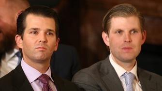 U.S. President Donald Trump's sons Donald Trump Jr. (L) and Eric Trump sit in the audience waiting to watch their father announce his nominee for the  empty associate justice seat at the U.S. Supreme Court, at the White House in Washington, D.C., U.S. January 31, 2017.  REUTERS/Carlos Barria