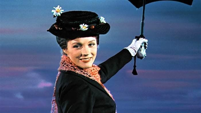 "Julie Andrews holding her character's umbrella in ""Mary Poppins."""