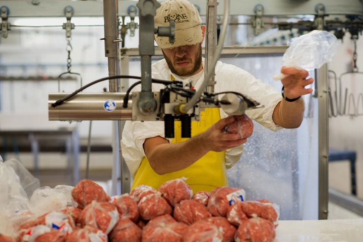An employee packs ground turkey in Hamilton, New Jersey, on Oct. 21, 2013. Meatpackers are susceptible to injuries, but Repub