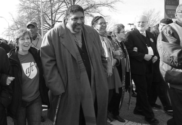 Weingarten with the Rev. Dr. William Barber at the Moral March on Raleigh, N.C., on Feb. 11.