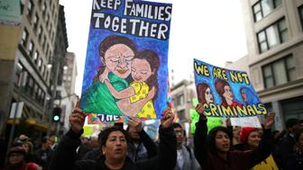People participate in a protest march calling for human rights and dignity for immigrants, in Los Angeles, February 18, 2017. REUTERS/Lucy Nicholson