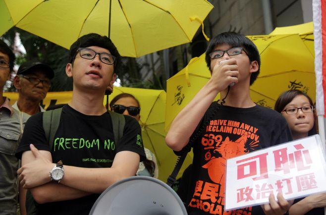 Nathan Law (left) and Joshua Wong on July 14, 2015./ Source: AFP, Yonhap News