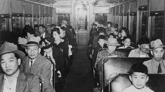 (Original Caption) 1942-Internment of Japanese-Americans during WWII: 'Evacuation' of the Niseis from California: Interior scene in an electric train en route to the assembly center. Photograph, 1942.