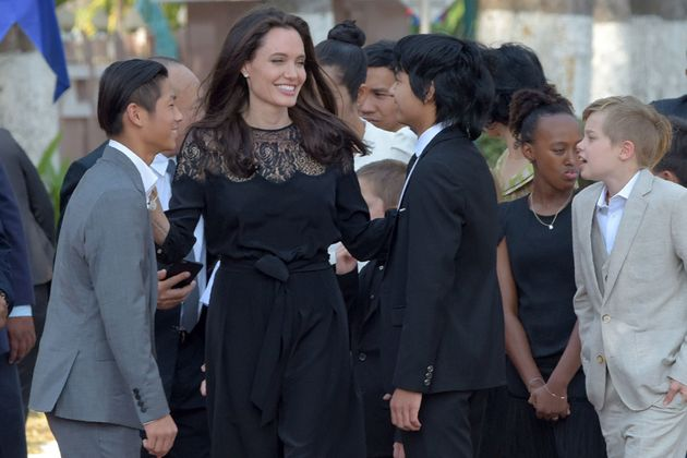 Angelina Jolie and her children, including Maddox (center), gather at the royal residence for a meeting...