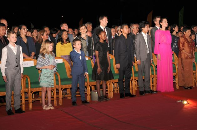 Angelina Jolie and her children listen to the Cambodian national anthem during the premiere of Jolie's...