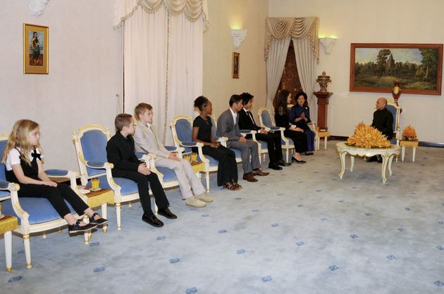 Angelina Jolie's children look on as their mother attends an audience with Cambodian King Norodom Sihamoni...