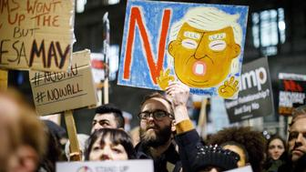 LONDON, UNITED KINGDOM - JANUARY 30:  People protest against the US travel and immigration ban from seven Muslim-majority countries and demand President Donald Trump's planned state visit to the UK to be cancelled outside Downing Street in London, England on January 30, 2017. (Photo by Tolga Akmen/Anadolu Agency/Getty Images)
