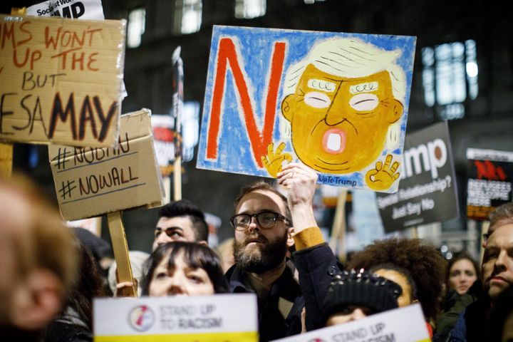 People protest against the U.S. travel and immigration ban from seven Muslim-majority countries and demand President Donald T