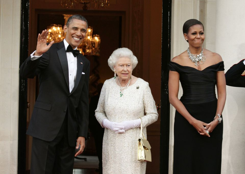 LONDON, ENGLAND - MAY 25: (L-R) U.S. President Barack Obama, Queen Elizabeth II and First Lady Michelle Obama arrive at Winfi