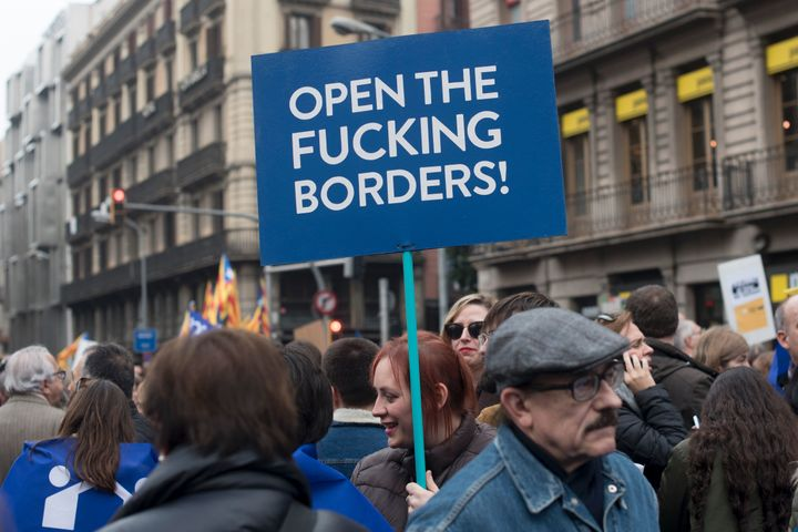 A woman marches in the pro-refugee demonstration in Barcelona on Saturday.