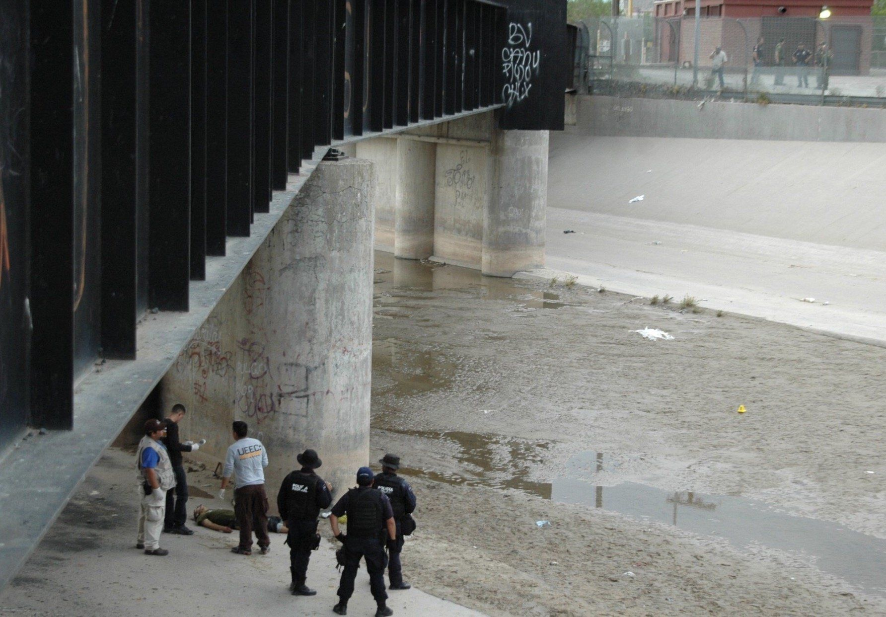 In this image provided by lawyers for Sergio Hernandez's family, the teen's body is seen lying under the bridge that sep