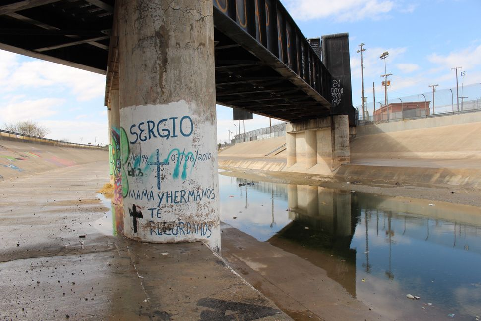 Graffiti on the bridge piling between the U.S. city of El Paso and the Mexican city of Ciudad Juárez commemorates the