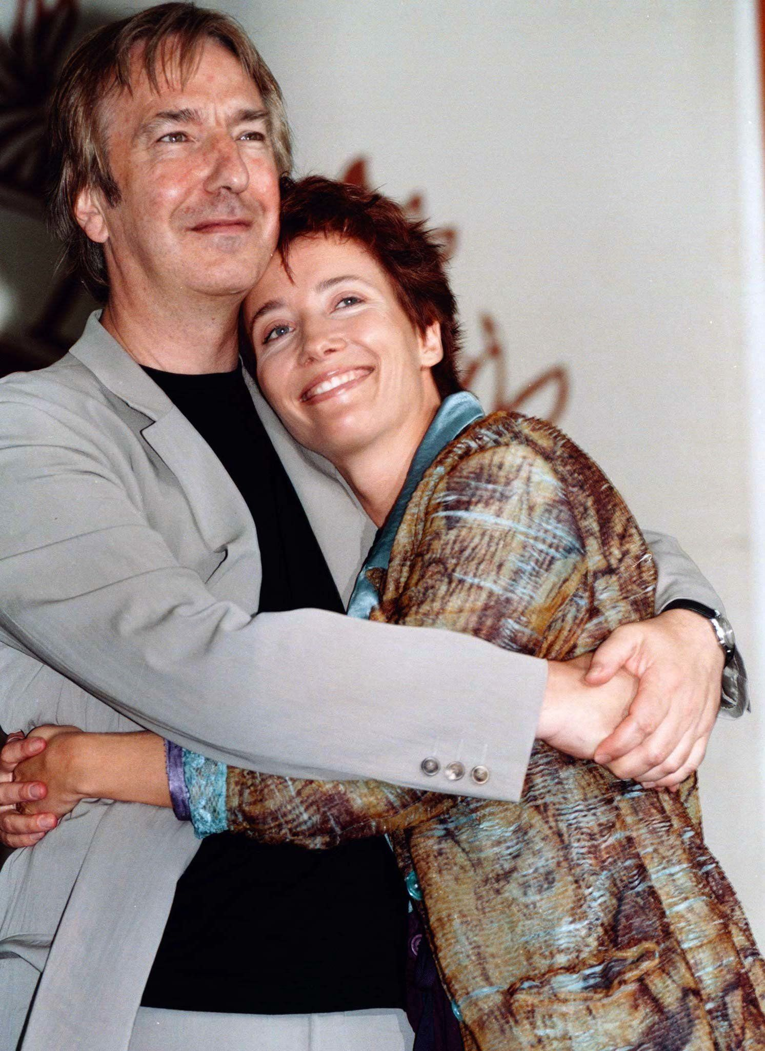 Alan Rickman and Emma Thompson embrace at the Venice Film Festival in