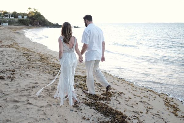 """Caroline Duncan and Jeremy Gifford of Washington, D.C. said 'I do' on the beach in Vieques, Puerto Rico on Saturday."" -"