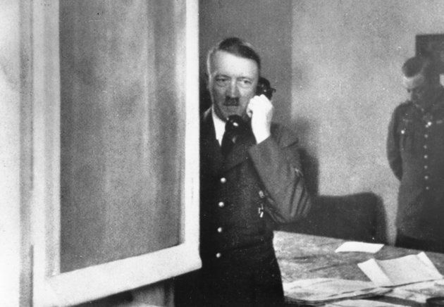 The German leader pictured using a telephone in