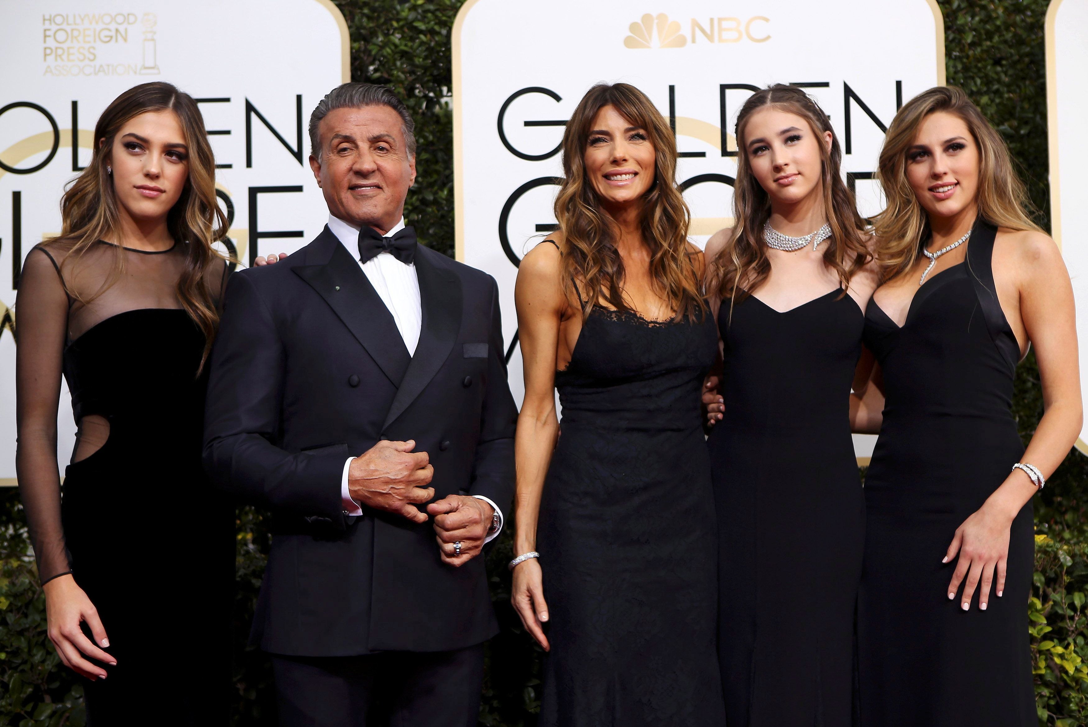 Actor Sylvester Stallone poses with his wife Jennifer Flavin (C), and their daughters, Sistine Stallone (L), Scarlet Stallone (2nd R) and Sophia Stallone during the 74th Annual Golden Globe Awards.