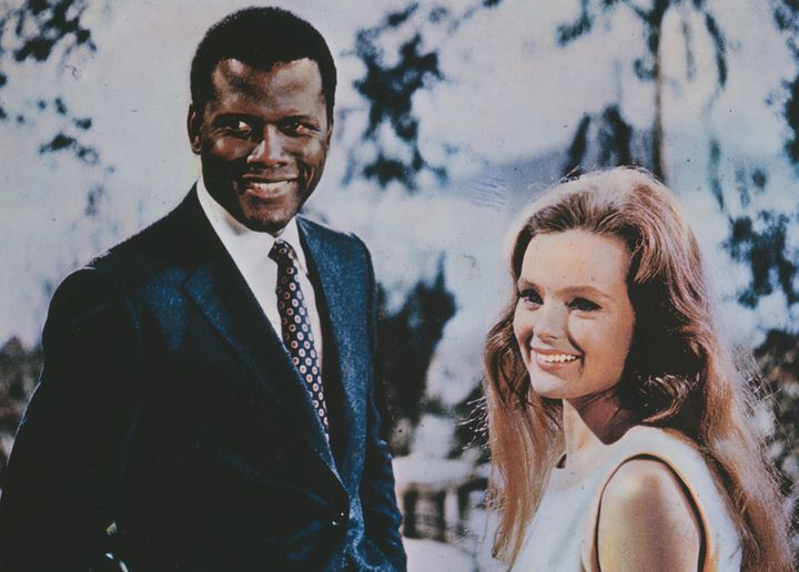 "Actors Sidney Poitier and Katharine Houghton appear on the poster for ""Guess Who's Coming To Dinner."""