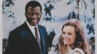 Actors Sidney Poitier and Katharine Houghton appear on the poster for the Columbia Pictures film 'Guess Who's Coming To Dinner', 1967. (Photo by Movie Poster Image Art/Getty Images)