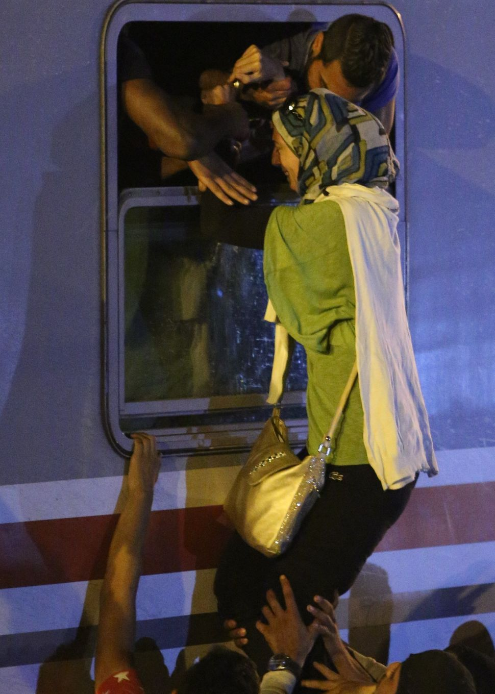 A stampede occurs as Middle Eastern refugees rush to find space on a train headed to Beli Manastir on September 18, 2015 in T