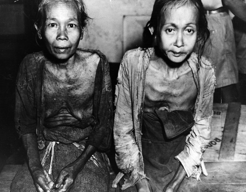 Two starving women at a rehabilitation camp in Jokjakarta, Indonesia, where they are being fed by Dutch Government Agencies o