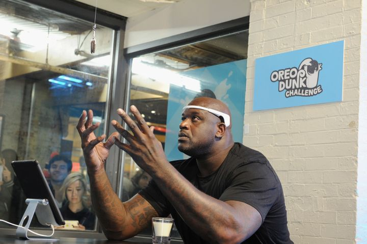 Shaq concentrating on his Oreo cookie.