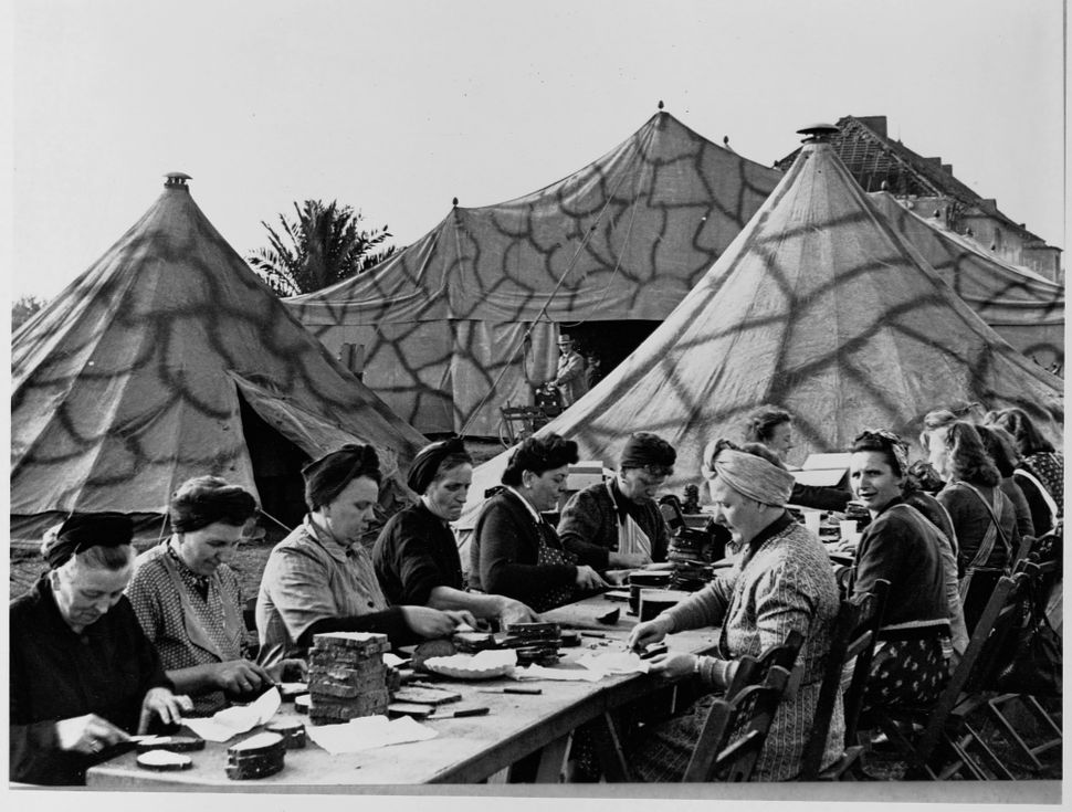 Women prepare a meal at a camp in Germany. The refugee camp was set up by the NSV, a welfare organization in Nazi Germany cir