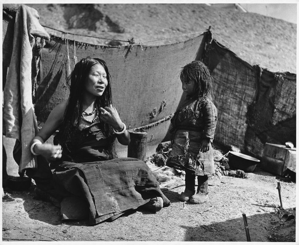 A Tibetan mother who has fled with her daughter over the Himalayas to Kalimpong, in northern Bengal on Feb. 24, 1951.