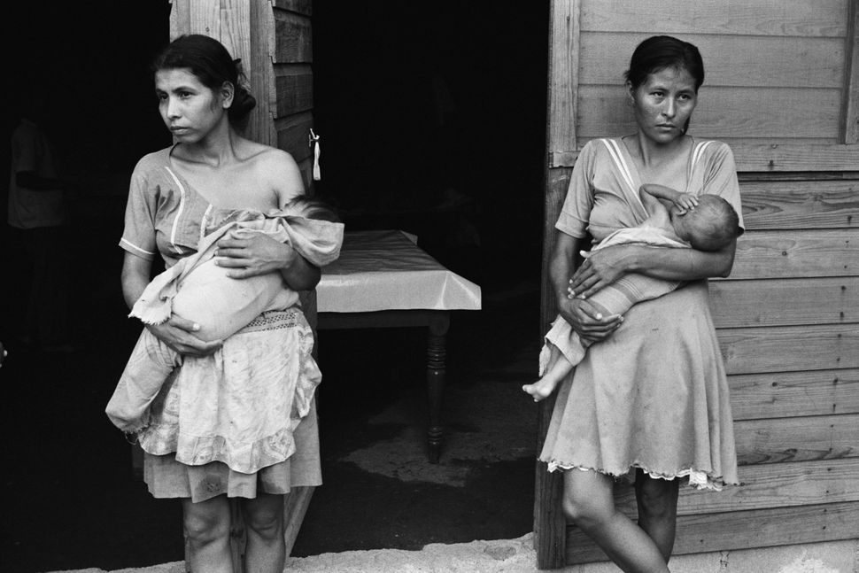 Women and their children in an El Salvadoran refugee camp at La Virtud, Honduras.
