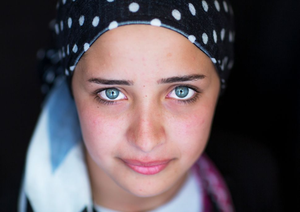 Close-up of a young syrian refugee face with blue eyes in Erbil, Kurdistan, Iraq on Sep. 21, 2013.