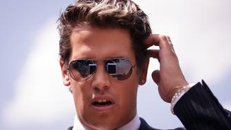 ORLANDO, FL - JUNE 15: Milo Yiannopoulos, a conservative columnist and internet personality, looks at his tablet device during a press conference down the street from the Pulse Nightclub, June 15, 2016 in Orlando, Florida. Yiannopoulos was briefly banned from Twitter on Wednesday. The shooting at Pulse Nightclub, which killed 49 people and injured 53, is the worst mass-shooting event in American history. (Photo by Drew Angerer/Getty Images)