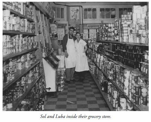 Sol and Luba inside their grocery shop