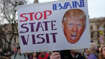 Thousands of protesters holding placards take part in a rally in Parliament Square against US president Donald Trump's state visit to the UK on February 20, 2017 in London, England. MPs in the Houses of Parliament debate Mr Trump's state visit to the UK after a petition against it reached 1.8 million signatures.