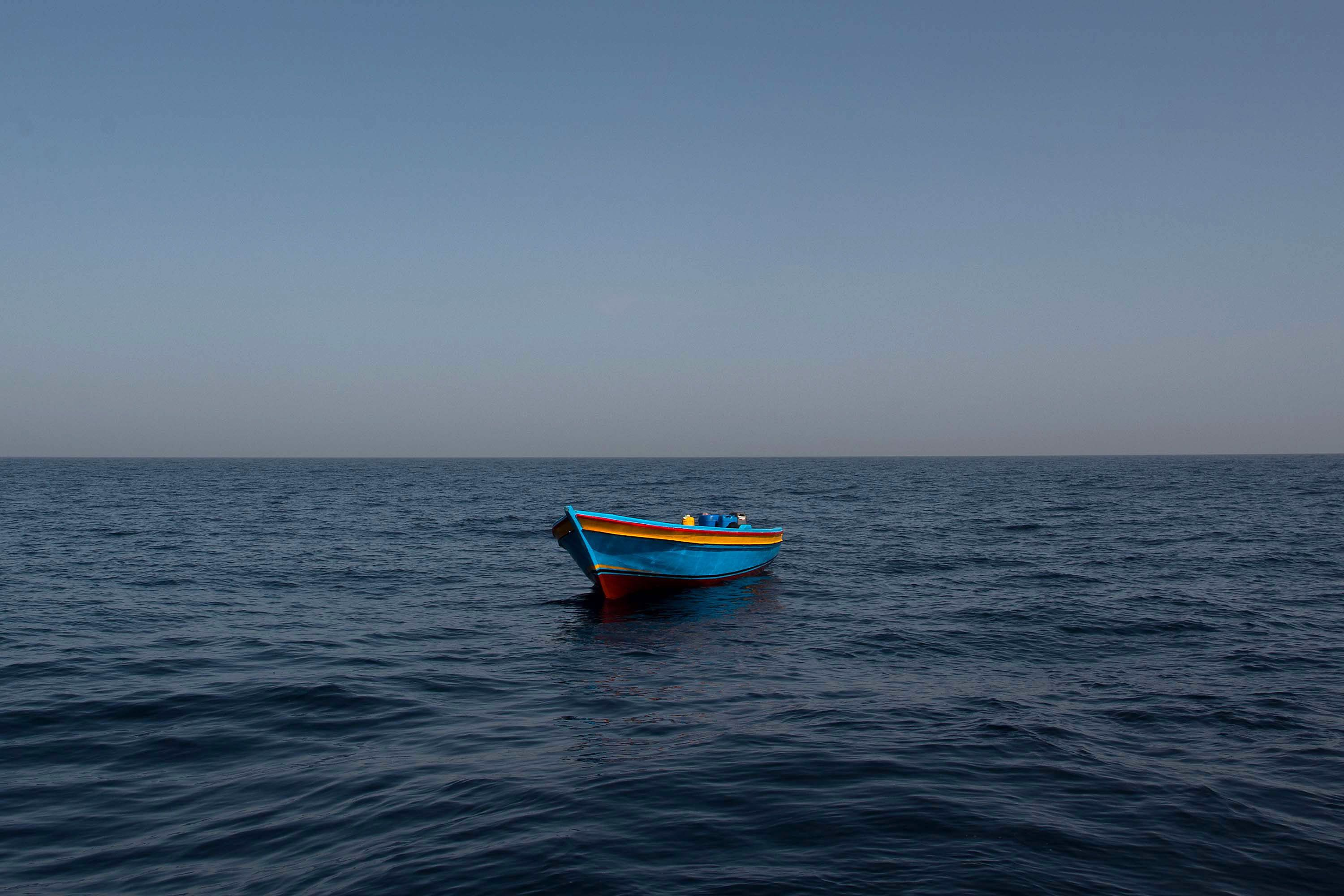 AT SEA, AT SEA - FEBRUARY 18:  An empty wooden boat is left behind after migrants and refugees were assisted by members of the Spanish NGO Proactiva Open Arms as they crowd it sailing out of control at 20 miles (38 km) north of Sabratha, Libya on February 18, 2017 at Sea. 466 migrants have been rescued in high seas since yesterday evening by the Italian Coast Guard and the Spanish NGO Proactiva Open Arms rescue vessel Golfo Azzurro as they continue to search for more boats. Proactiva Open Arms are a Spanish charity based out of Malta who provide search and rescue assistance to refugees and migrants in distress at sea. They patrol the SAR and Rescue Zone off the coast of Libya running rescue missions for the hundreds of migrants who continue to make the perilous journey across the Mediterranean in the hope of reaching the European mainland.  (Photo by David Ramos/Getty Images)