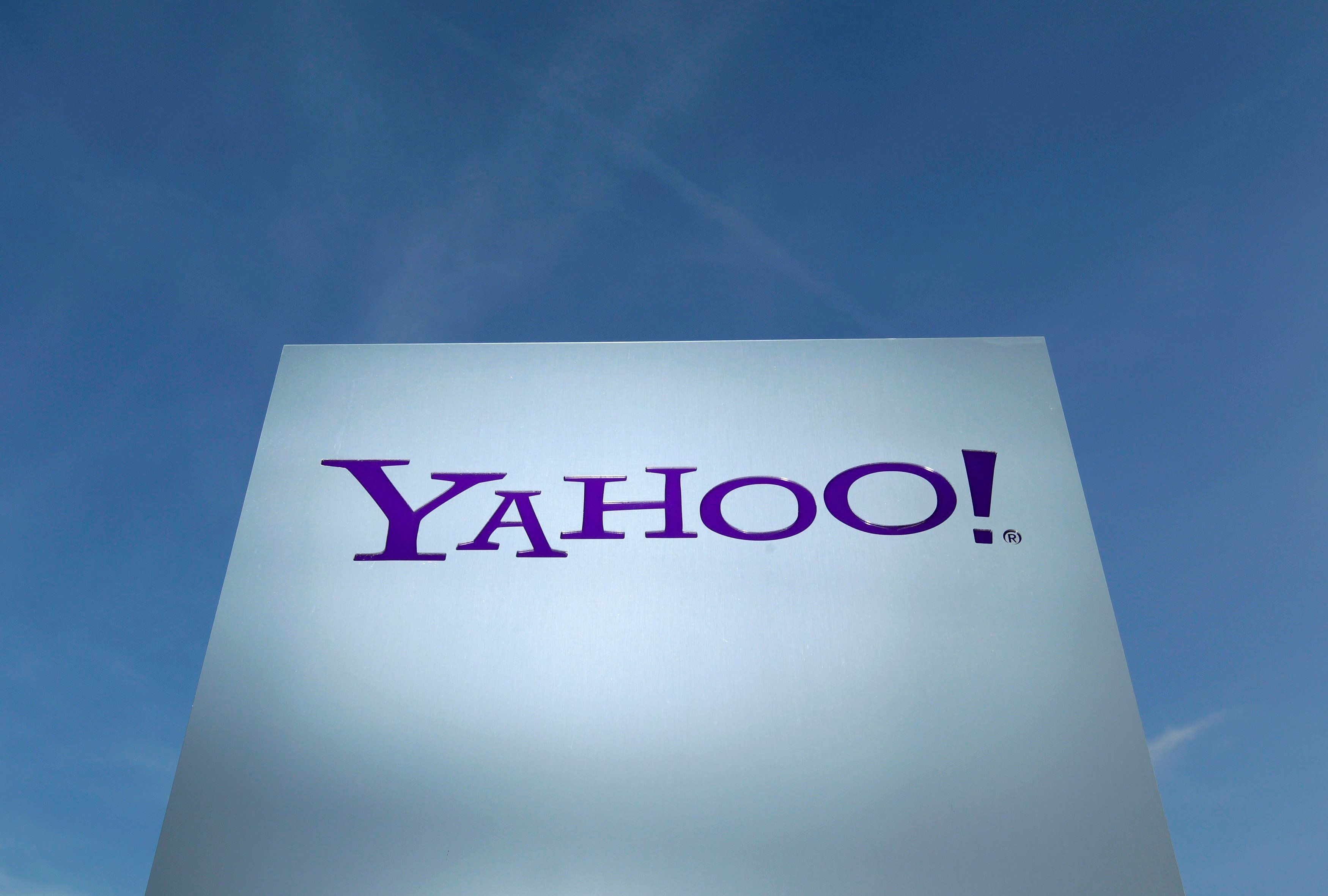 A Yahoo logo is pictured in front of a building in Rolle, Switzerland December 12, 2012.   REUTERS/Denis Balibouse/File Photo            GLOBAL BUSINESS WEEK AHEAD PACKAGE    SEARCH BUSINESS WEEK AHEAD 17 OCT FOR ALL IMAGES