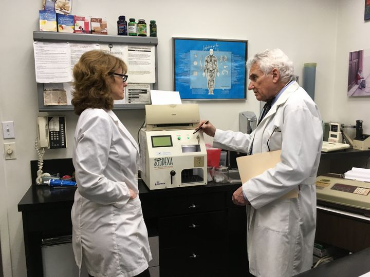 Dr. Howard Shapiro discusses a patient's progress with assistant Alexandra Lotito at his midtown Manhattan office. Shapiro sa