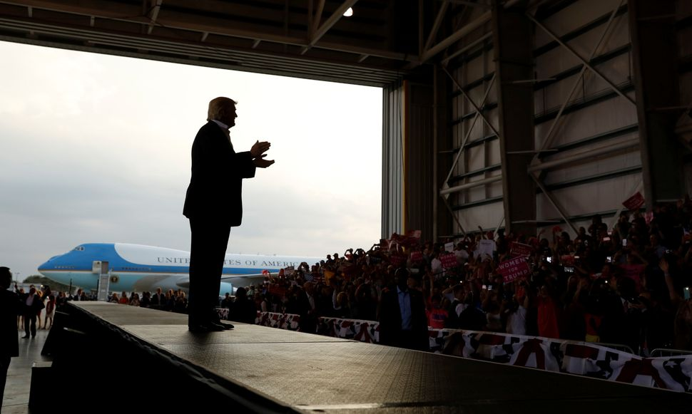 "Trump applauds his crowd as he holds a ""Make America Great Again"" rally at Orlando Melbourne International Airport in Melbour"