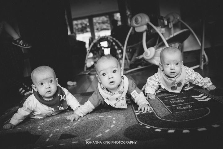 The triplets were born two months early and spent about a month in the hospital.
