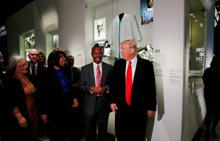 President Donald Trump stands with his nominee to lead the Department of Housing and Urban Development, Dr. Ben Carson, on Tu