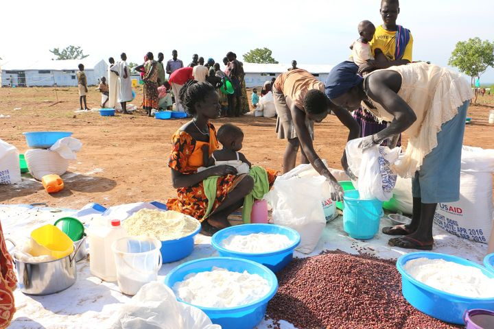 Victims fleeing South Sudan's war receiving food aid from WFP and the U.S. Food for Peace program. Tragically, there have bee