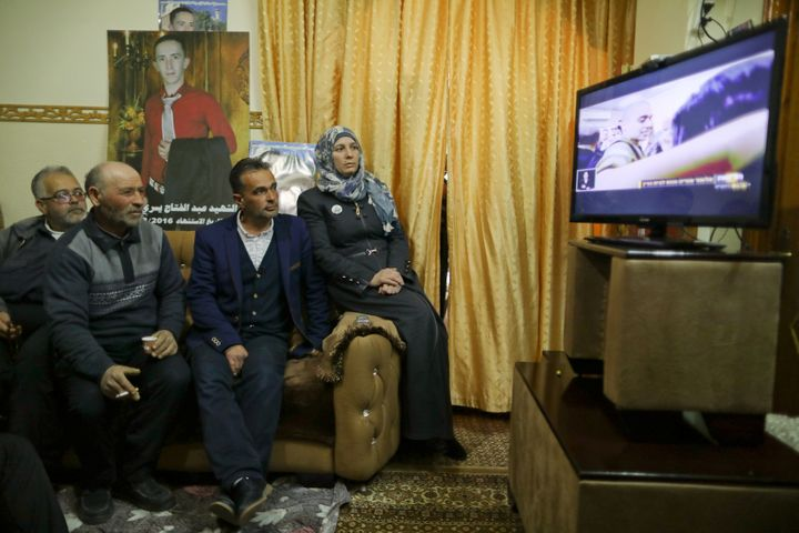 The parents and relatives of Palestinian Abd Elfatah Ashareef watch the TV broadcast of the sentencing.