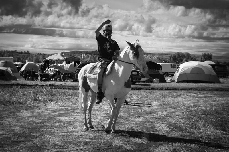MJ, a young water protector patrolling the camp for security with his horse Champagne. The Standing Rock Sioux tribe has oppo