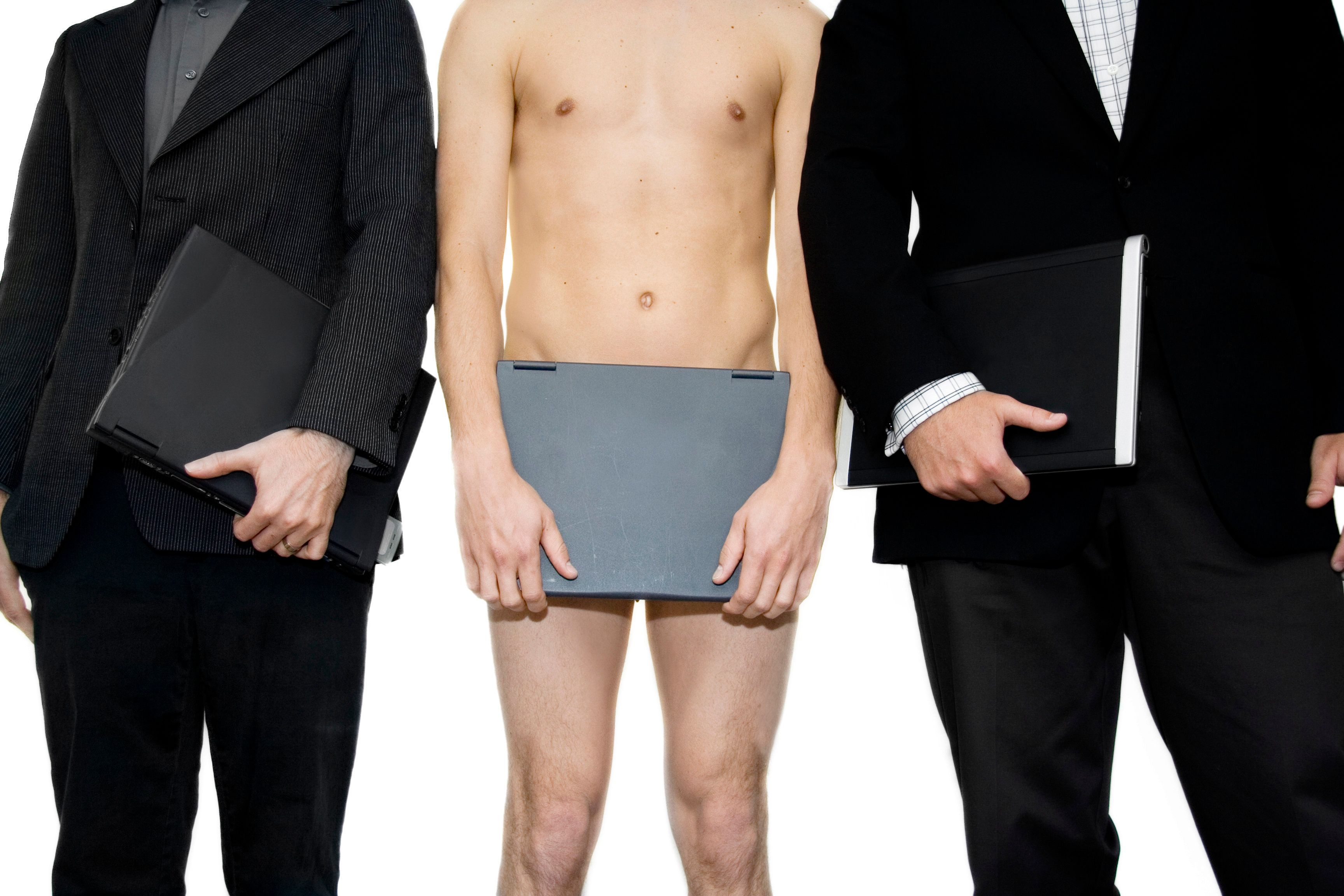 Naked man covering self with laptop standing in between two businessmen