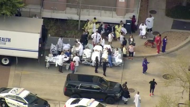 Patients are seen being lined up outside the hospital after reports of a shooting.